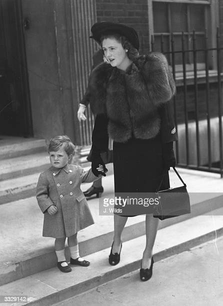 Politician Winston Churchill leaves home with his mother Pamela Churchill Young Winston is acting as a page to Lady Sarah Churchill at her wedding
