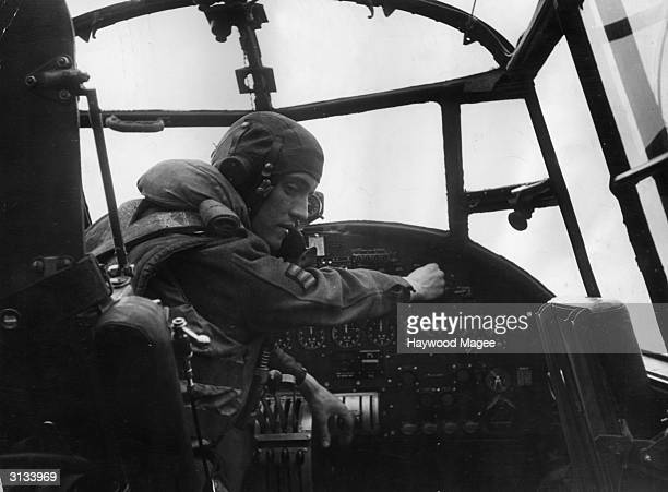 Sergeant John McKintosh of the RAF starts the engine of his Lancaster bomber after a painstaking check of the plane's systems Original Publication...