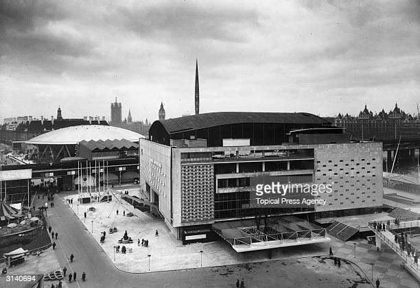 The Royal Festival Hall at the time of the Festival of Britain with the Dome of Discovery' and the Skylon In the background are the Houses of...