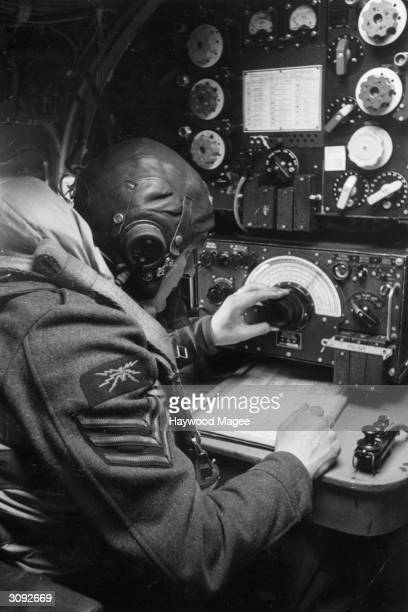 A wireless operator in an Avro Lancaster checks his equipment before the seven man crew take off Original Publication Picture Post 1437 The Last Hour...
