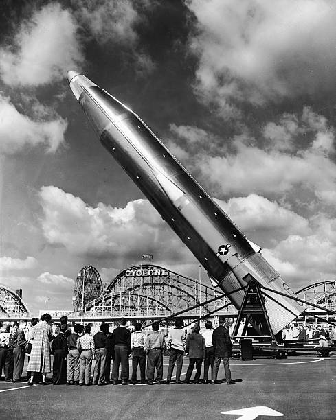 A group of children watches as the first American ICBM...