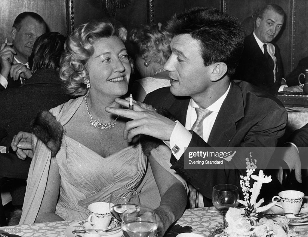 Actor Laurence Harvey (1928 - 1973) in Pruniers Restaurant, London, with the former Susan Nell, now the wife of actor Michael Wilding.