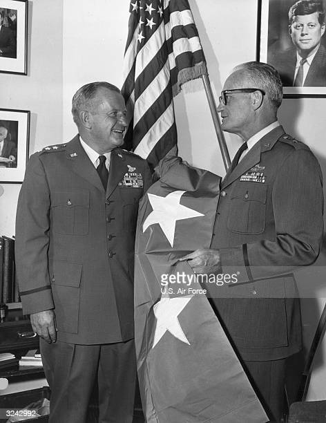 Lieutenant General Edward Timberlake presents United States senator Barry Goldwater with a twostar flag on the occasion of his promotion to Major...