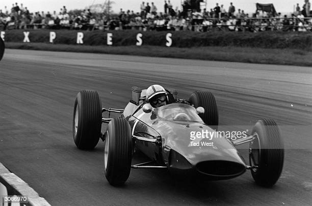 Racing driver John Surtees competing in an International Trophy Race in a Ferrari formula one car at Silverstone Earlier in the day a loose wheel...