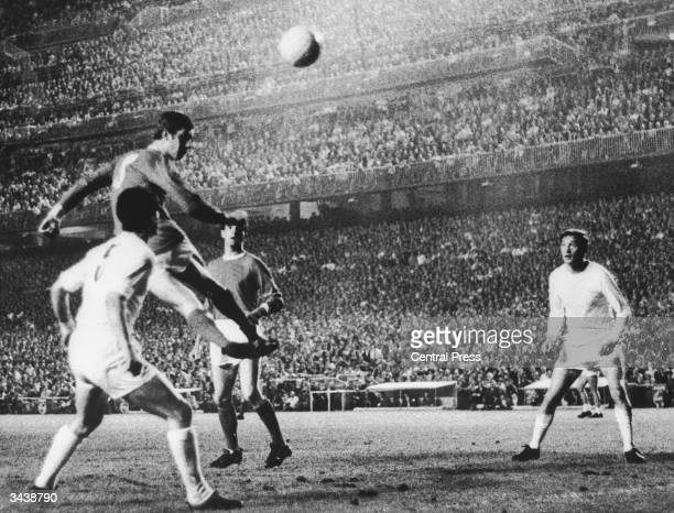 Brian Kidd of Manchester United gets up to head the ball in the European Cup second leg semifinal against Real Madrid at the Bernabau Stadium in...