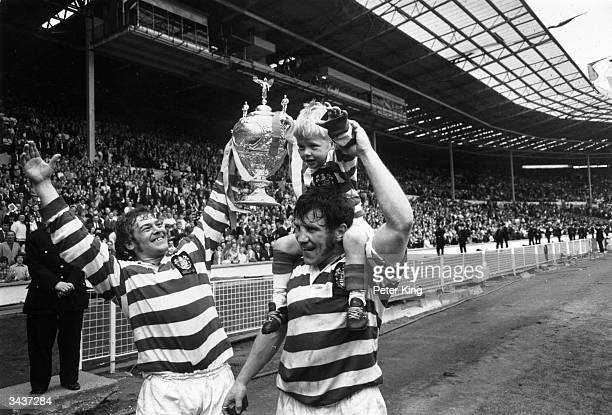 Kevin Ashcroft and Peter Smethurst carry 4 year old mascot Gary Ashcroft aloft after Leigh win the Rugby League Challenge Cup beating Leeds in the...