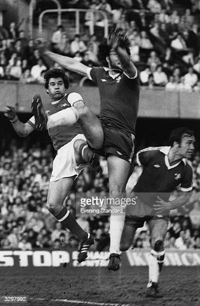 The Arsenal football player Malcolm McDonald in a match against Chelsea Ron Harris a Chelsea player is also in the picture