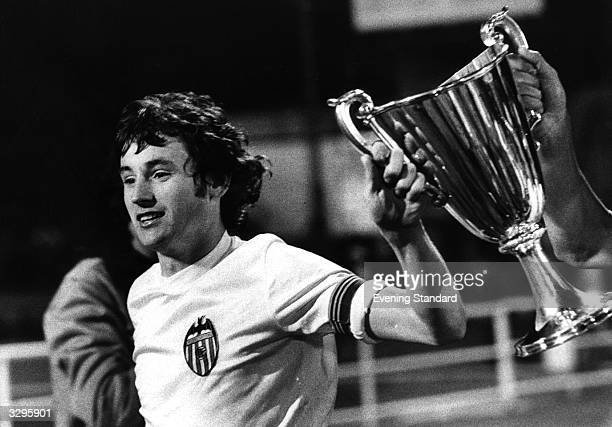 Valencia team captain Enrique Saura with the European Cup Winner's Cup trophy after his side's 54 victory on penalities over Arsenal at Heysel...