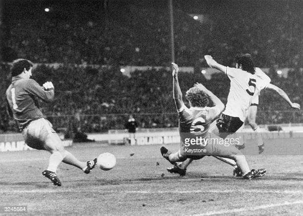 Tottenham Hotspur win the 100th FA Cup final in a replay against Manchester City at Wembley Stadium by 32 Ricardo Villa of Spurs beats Tommy Caton to...