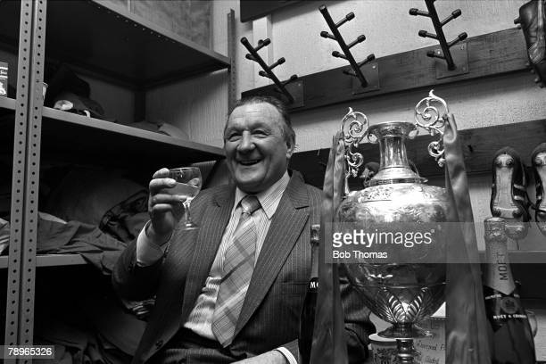 15th May 1982, Anfield, Liverpool, Liverpool FC Manager Bob Paisley toasts his sides Division One Championship success in the boot-room with the...