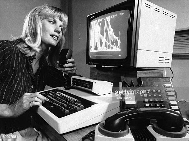 Deaf woman operates a microprocessor telephone by typing the message into the computer then dialling the number to which the message is to be sent....