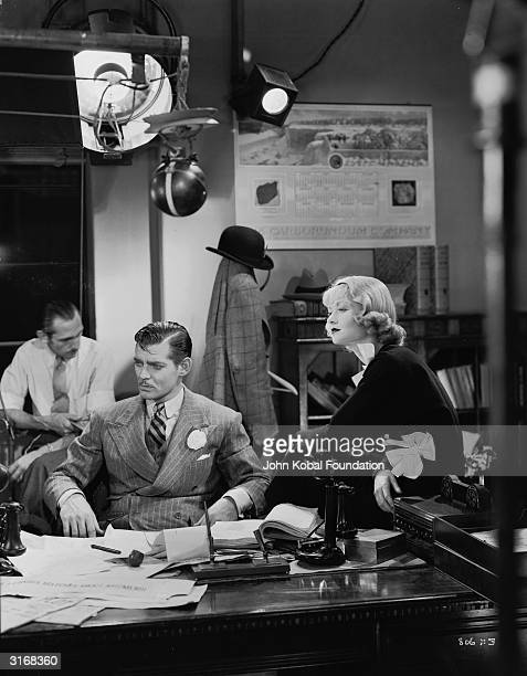 Clark Gable and Constance Bennett deep in thought in 'After Office Hours' directed by Robert Z Leonard