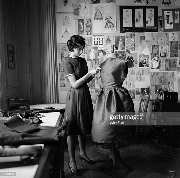 Christine Bartholomew attends a dressmaking session at the 'Monkey Club' an exclusive finishing school for young ladies run by Griselda JoynsonHicks...