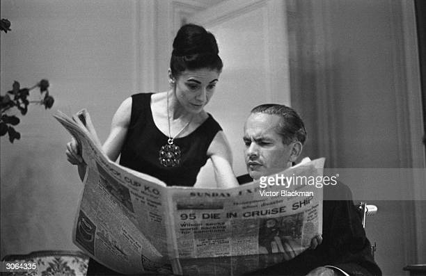 Panamanian diplomat Dr Roberto Arias and his wife ballerina Dame Margot Fonteyn reading the Sunday Express a British newspaper while on holiday in...