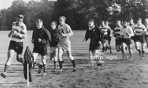 The New Zealand Rugby Union team, the All Blacks, in training in 1967.