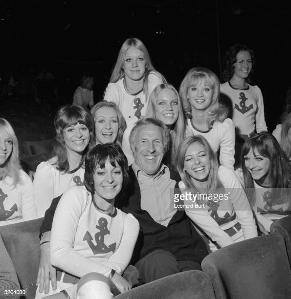 Bruce Forsyth looks particularly pleased with himself as he is surrounded by the 'Young Generation Dancers' at the London Palladium during rehearsals...