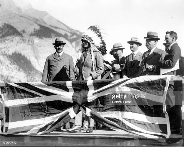 The Duke of Windsor then Edward Prince of Wales wearing an Indian headdress attends an Indian display at Banff during his royal tour He succeeded his...