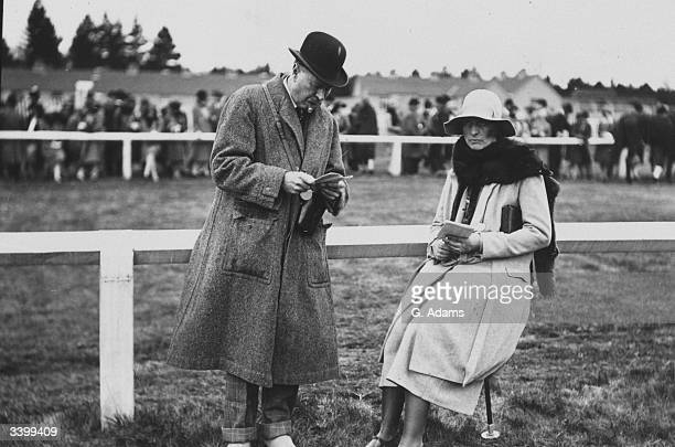 Major de Winter and Mrs V Henry beside the race course at Ludlow steeplechases