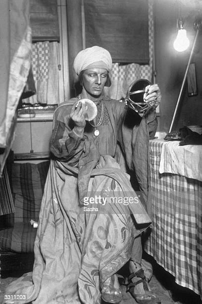 John Gielgud makes himself up as Prospero for the Old Vic's production of 'The Tempest'