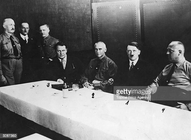 The heads of the Fascist Party in the Fraction Room of the Reichstag Adolf Hitler leader Dr Frick Thuringian Minister of the Interior Hermann Goering...