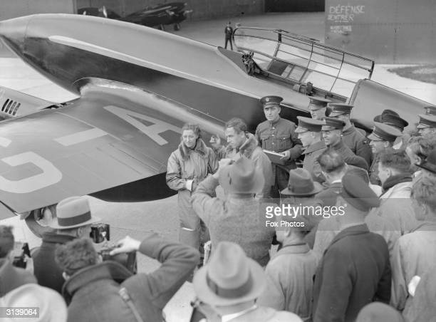 Aviators Jim Mollison with his wife Amy Johnson and the de Havilland Comet they are flying in the Australian Air Race