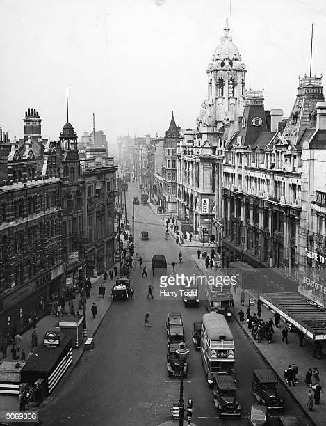 Tottenham Court Road a street in London's busiest shopping district Near the underground station are the Dominion Theatre and the YMCA
