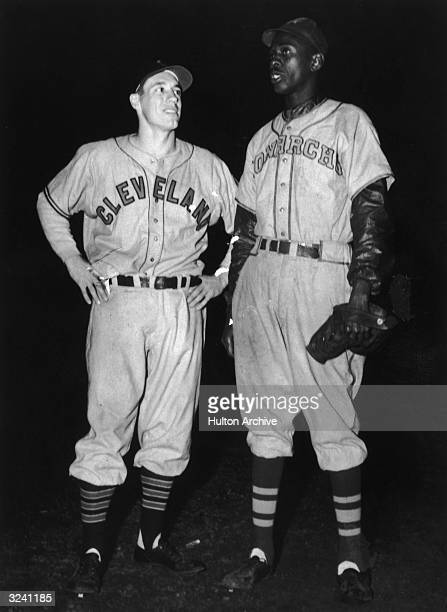 American baseball pitchers Bob Feller of Cleveland Indians , and Leroy 'Satchel' Paige of Kansas City Monarchs, standing together after their teams...