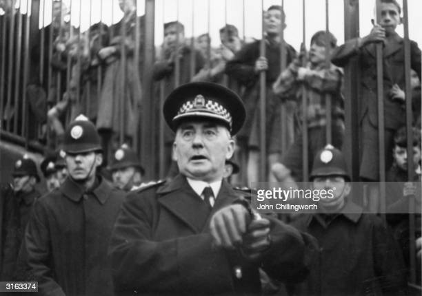A police officer checks the time at the start of the match between arch rivals Glasgow Rangers and Celtic at Ibrox Stadium Glasgow Original...