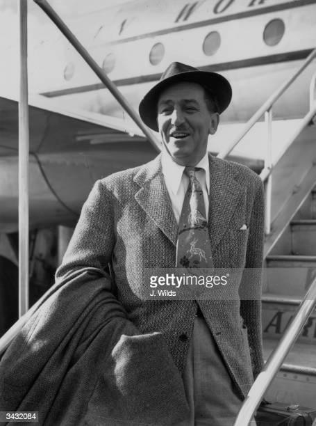 American cartoonist and film producer Walt Disney arrives at London Airport