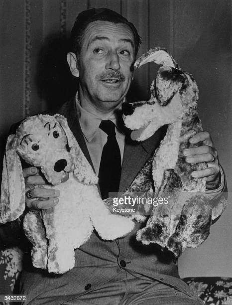 American cartoonist and film producer Walt Disney introducing his two new canine characters who star in his latest film 'The Lady And The Tramp'