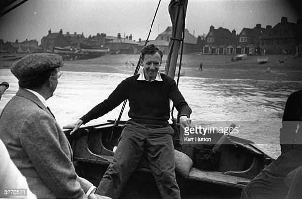 English composer Benjamin Britten with novelist Edward Morgan Forster left in a boat off the beach at Aldeburgh Original Publication Picture Post...
