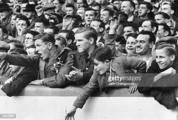 Excited fans at Ibrox in Glasgow, watching the football match between Glasgow Rangers and Celtic. Large crowds always gather for the 'Old Firm'...