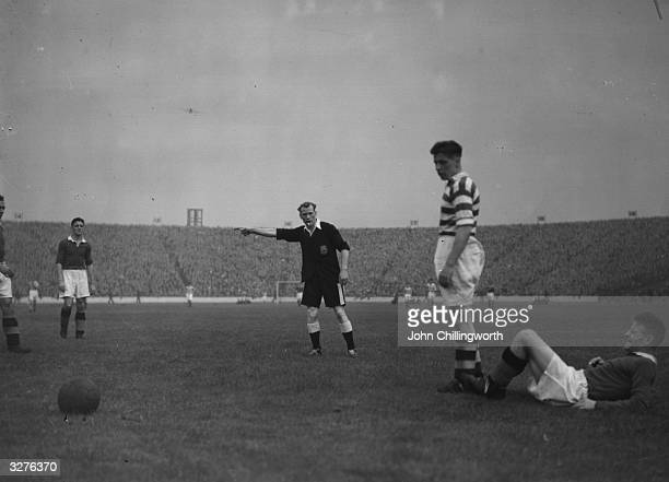 Rangers' Jock Shaw on the right is fouled by Celtic's James McGuire and the referee awards a penalty kick during a match between Glasgow Rangers and...