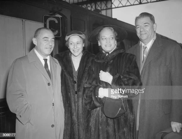 On the left with his wife Richard Rodgers composer of the music for 'The King and I' and 'South Pacific' with on the right Oscar Hammerstein II...
