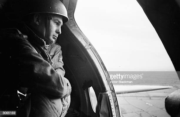 Daily Express newspaper photographer Terry Fincher on a parachuting exercise.