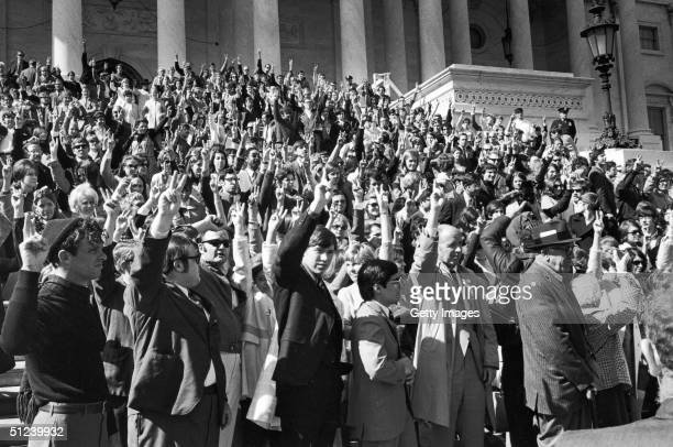 15th October 1969 A crowd of people display the peace hand gesture during an antiwar rally in front of the Washington Monument Washington D CThe...