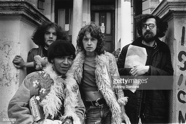Three squatters outside their house at 19 Elgin Avenue central London Note the fashionable Afghan coats worn by two of the young hippies
