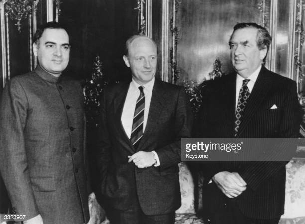Indian Prime Minister Rajiv Gandhi with Neil Kinnock and Denis Healey on an official visit to London to discuss Britain's attitude to sanctions...