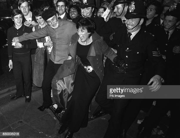 On this day in 1970, The Beatles movie 'Let It Be' premieres in London. Comedian Spike Milligan and wife Patricia Ridgeway join hands with the police...