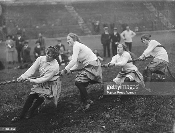 Contestants taking part in a tug of war during waitresses sports at Stamford Bridge in Chelsea, London.