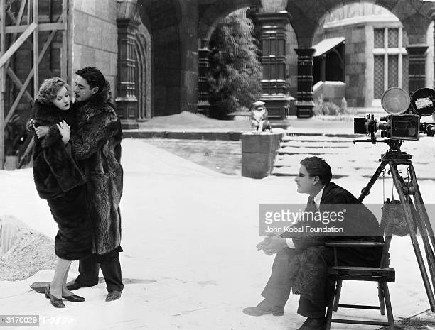 Actor John Gilbert wrestles with Greta Garbo on the set of 'Flesh and the Devil' directed by Clarence Brown