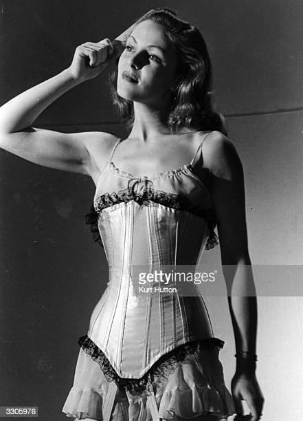 Film actress Hazel Court wearing a bustle Original Publication Picture Post 2041 What Bustles pub 1945