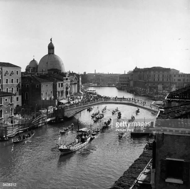 Regatta in the grand canal at Venice. Original Publication: Picture Post - 5402 - Venice Canal Party - pub. 1951