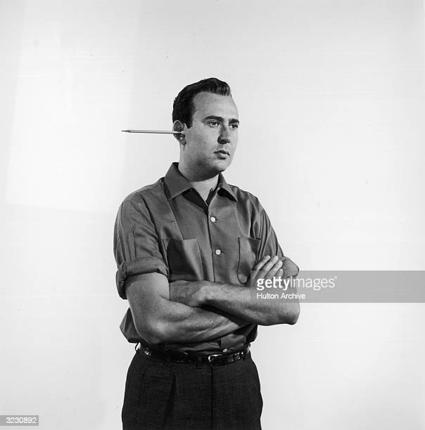 American actor and comedy writer Carl Reiner with a pencil protruding from one ear