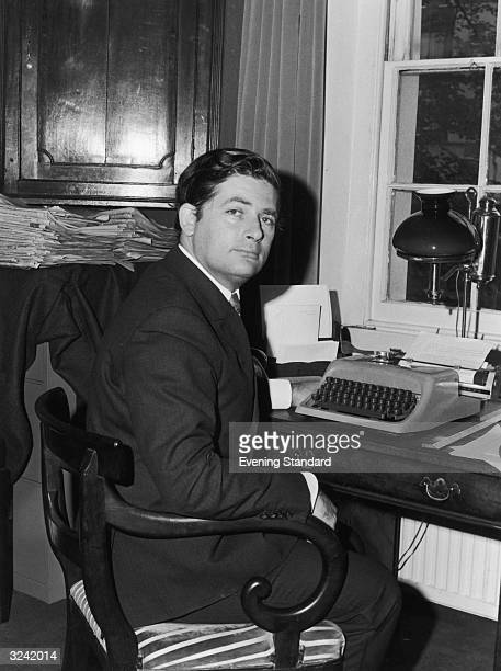 Conservative politician and journalist Nigel Lawson at home in his study