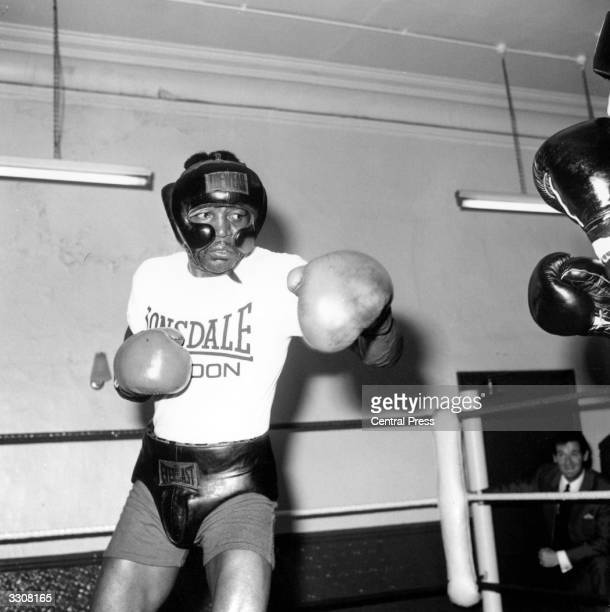 Boxer Bob Foster, currently world light heavyweight champion, training at a gym in London.