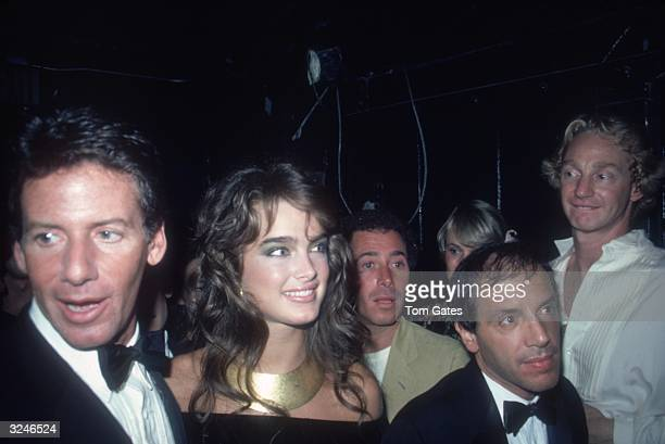 American fashion designer Calvin Klein model and actor Brooke Shields and club owner Steve Rubell among the crowd attending the reopening of the...