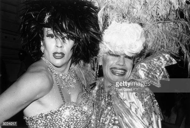 Drag queens Angel Jack and Hibiscus pose in sequined and feathered costumes at the reopening of Studio 54 New York City