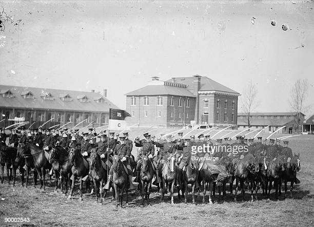 15th US Mounted Cavalry is formation drills at their base in Fort Bliss Texas with Headquarters Building in Rear