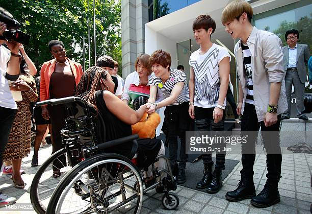 15year old American girl Donica Streling meets with members of SHINee and Super Junior at SM Entertainment head office on June 20 2012 in Seoul South...